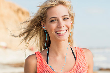 Girl wearing Neon Earbuds