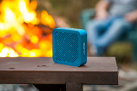 Front and Side View of Blue Crasher Mini Bluetooth Speaker on Wooden Ledge