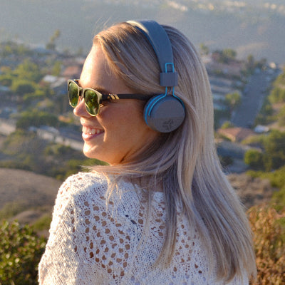 Girl wearing Neon Bluetooth Wireless On-Ear Headphones in blue