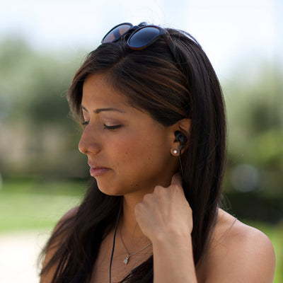 Woman Wearing Midnight Black and Gunmetal Diego Earbuds