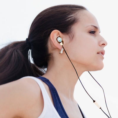 Woman Running with Pacific Blue and Midnight Black Diego Earbuds