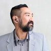 Businessman Wearing Black Epic Executive Earbuds