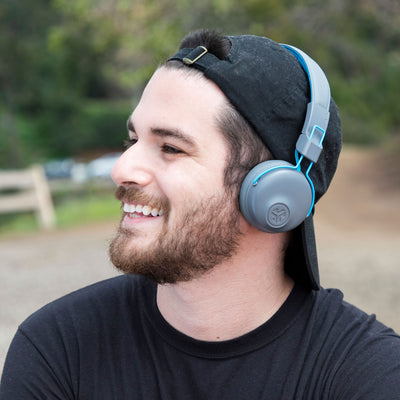 Guy wearing Studio Bluetooth Wireless On-Ear Headphones in blue