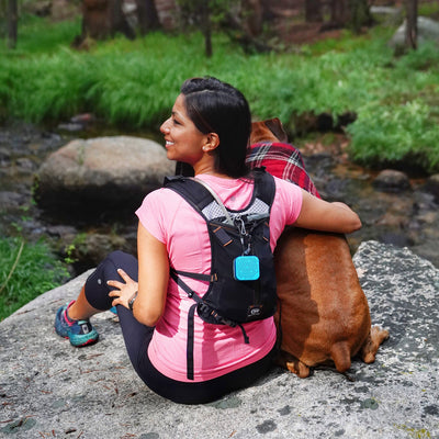 Woman Outdoors with Blue Crasher Micro Speaker Attached to Backpack