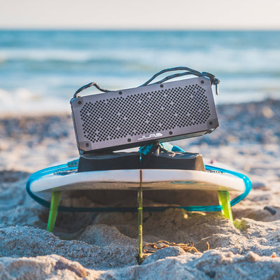 Gunmetal Crasher XL Bluetooth Speaker on Surfboard
