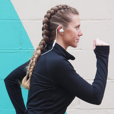 Woman Running Wearing White Epic Sport Wireless Earbuds