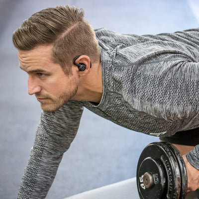 f80fc665bcf Man Lifting Weights Wearing Black Epic Air True Wireless Earbuds