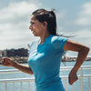 Woman Running Wearing Black Epic Air Elite True Wireless Earbuds