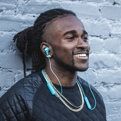 Man Wearing Blue Epic Executive Earbuds