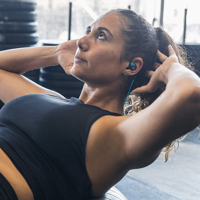 Woman wearing Fit Sport 3 Wireless Fitness Earbuds