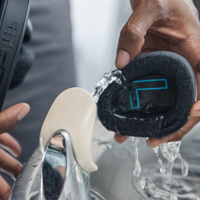 Rinsing Flex Sport Headphone Earcups Under Faucet