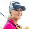 Woman Golfer Wearing Gravity Bluetooth Neckband Adapter and Earbuds