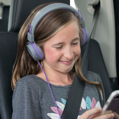 Girl wearing JBuddies Studio Over Ear Folding Headphones in Purple