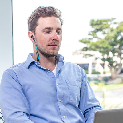Man wearing JBuds Elite Bluetooth Earbuds