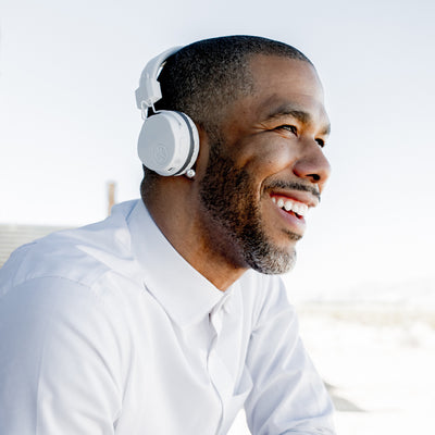 Guy wearing white Neon Bluetooth Wireless On-Ear Headphones