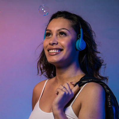 Girl wearing Rewind Wireless Retro Headphones in blue