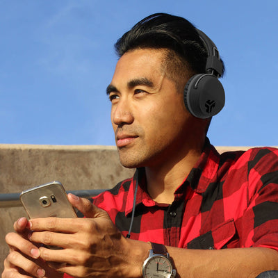 Guy wearing Neon On-Ear Headphones