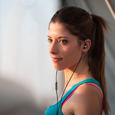 Woman Wearing Black Fit 2.0 Sport Earbuds