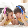 Boy and Girl Wearing Pink and Blue JBuddies Kids Headphones