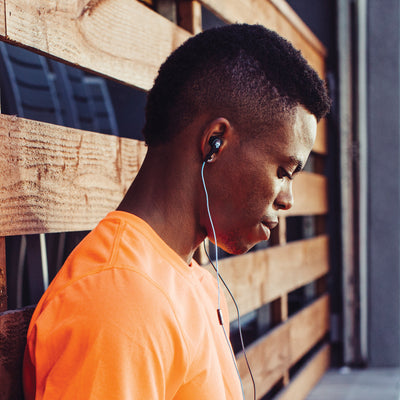 Man Wearing Blue Core Custom Fit Earbuds