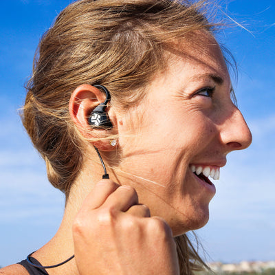 Woman Wearing and Touching Controls on Black Epic2 Wireless Earbuds