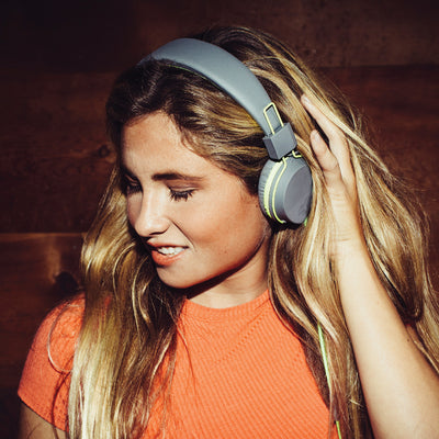 Girl wearing Neon On-Ear Headphones