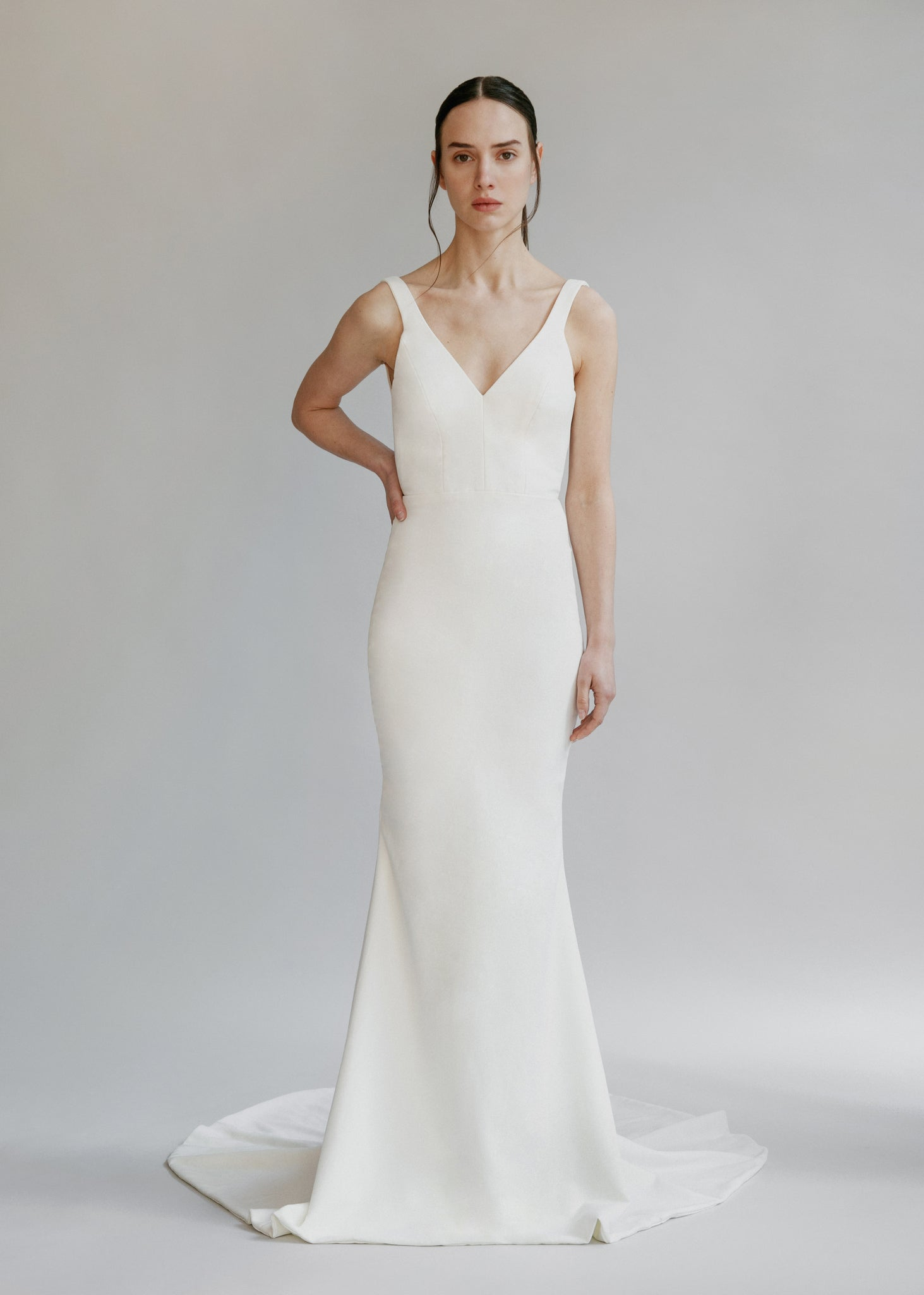 Simple classic crepe wedding dress with a square cut open back and a mermaid skirt