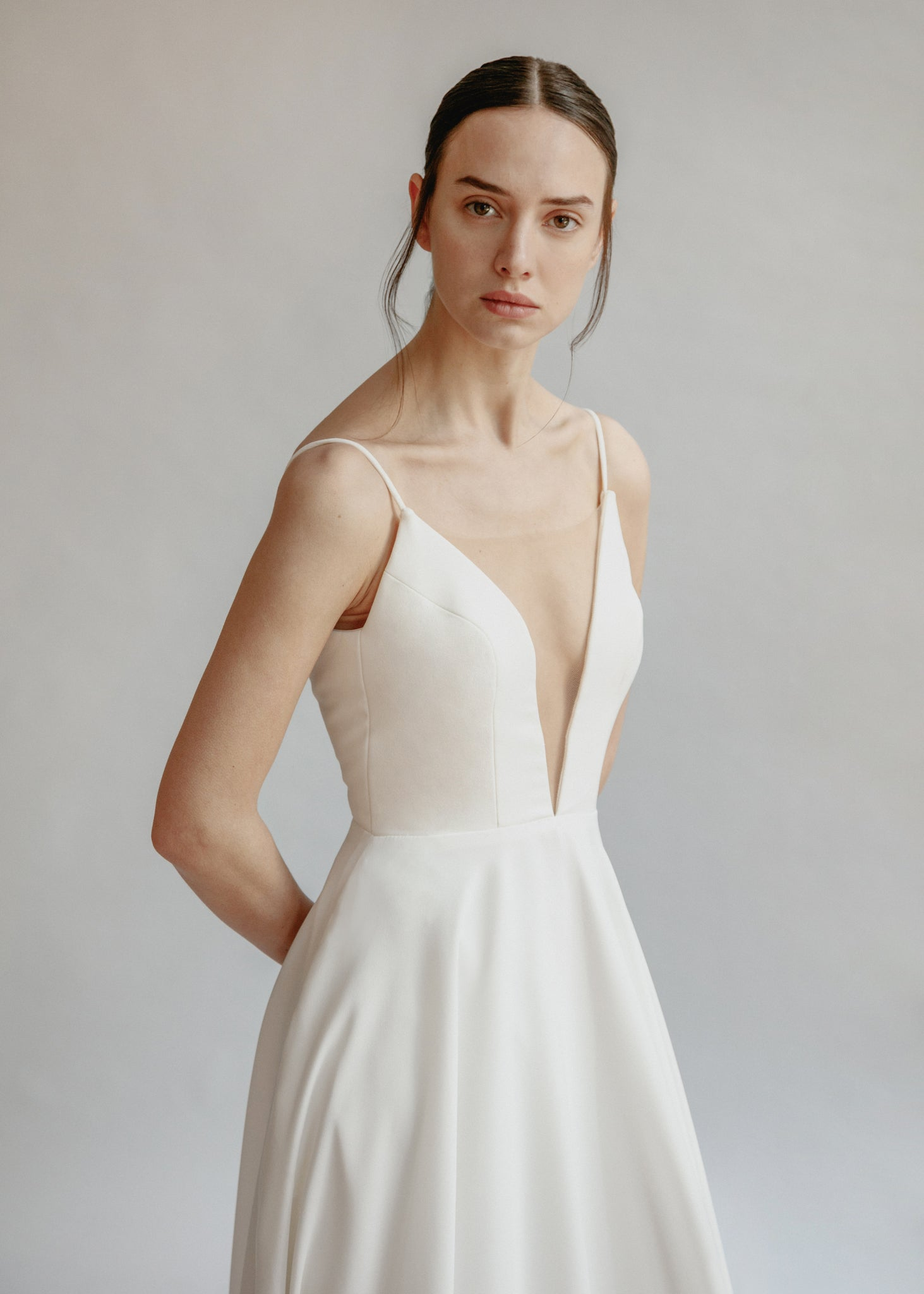 Low cut simple a-line wedding dress with pockets and an extra long train