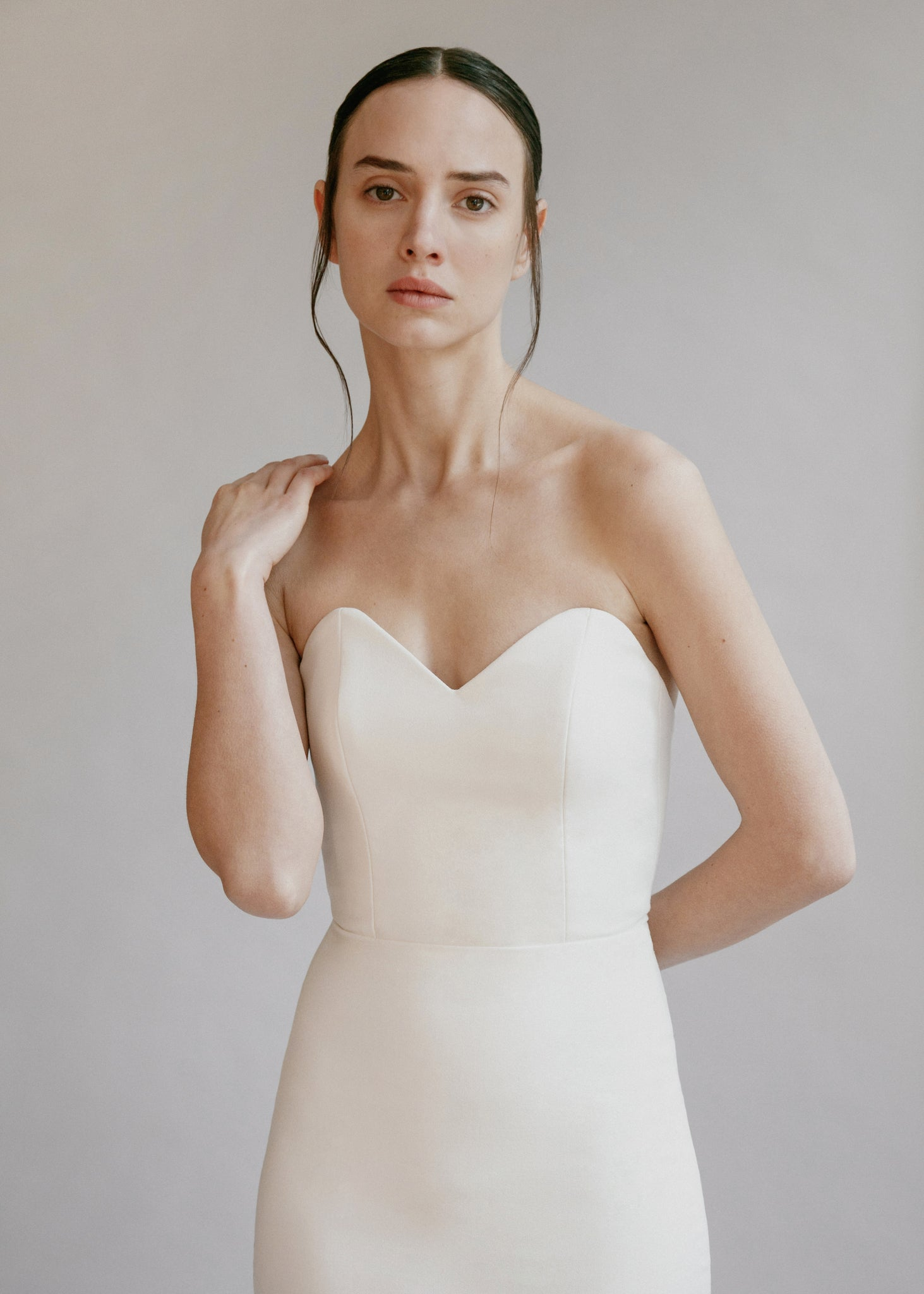 Minimalist strapless sweetheart wedding dress in full crepe