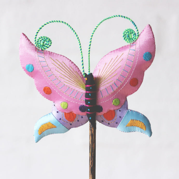 Handmade butterfly on a stick, plant decoration