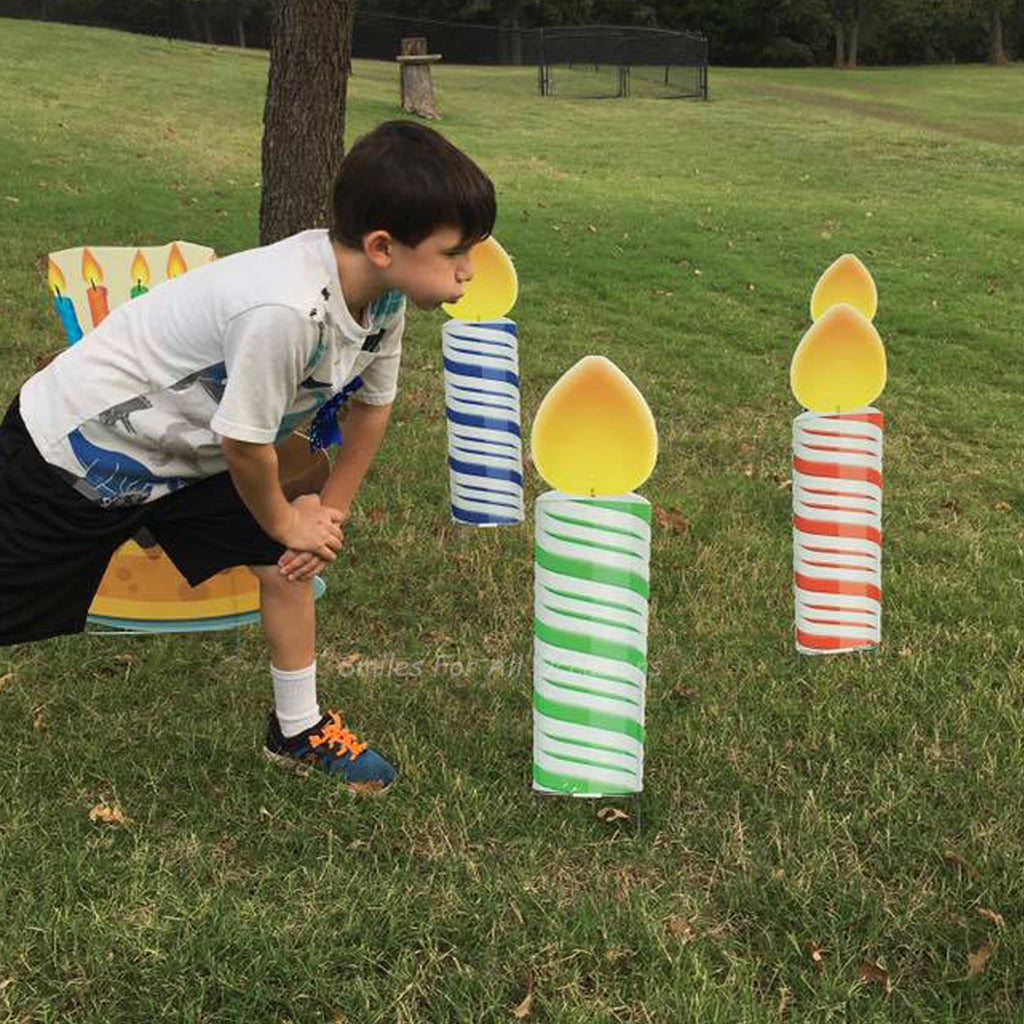 Little Boy Blowing out Yard Signs - Colorful Birthday Candles