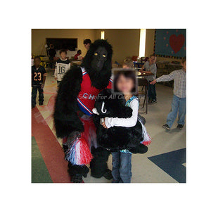 Black Gorilla in Cheer Leader Outfit with Little Girl Holding Stuffed Gorilla