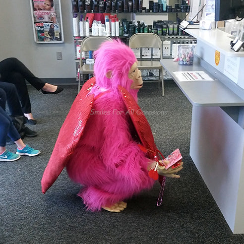 Pink Gorilla with Large Red Heart on Chest Hiding Behind Counter