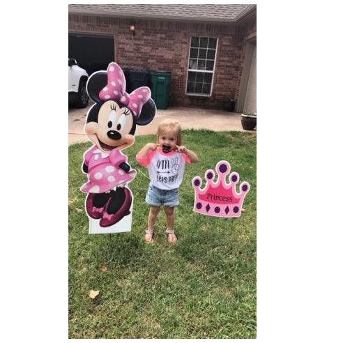 Little Girl Standing Next To Minnie Mouse and Princess Crown Yard Signs