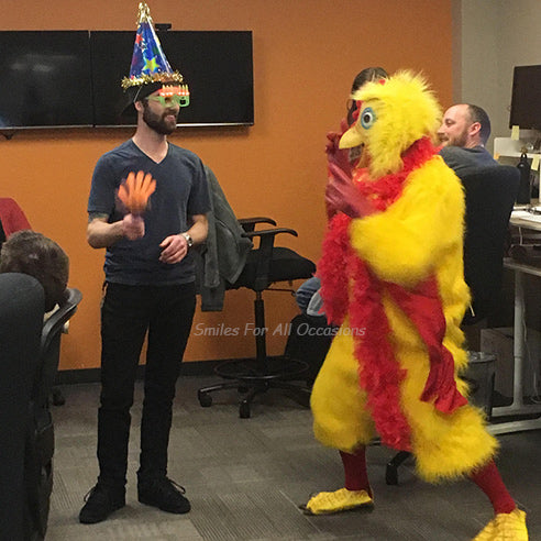 Yellow Chicken with Red Boa Singing to Man with Birthday Hat