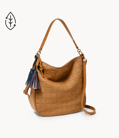 A slouching brown bag appearing suede-like with a short handle and a longer crossbody handle behind it.