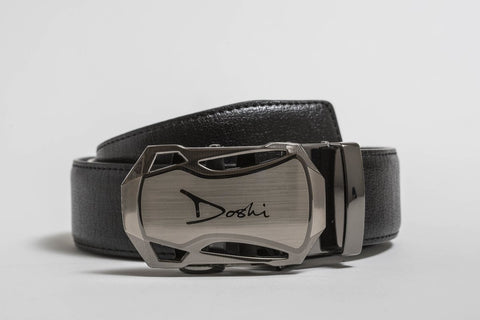 A black belt with a thick gunmetal colored buckle bearing the brand name Doshi.