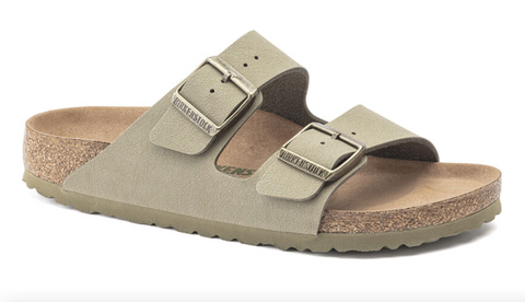 A tan two-strap sandle with a cork insole and silver buckles.