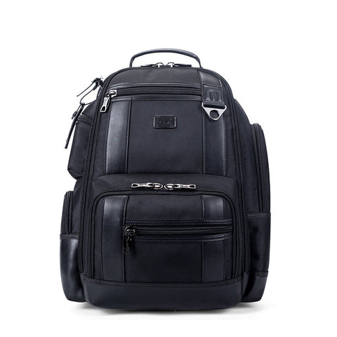 A black backpack with multiple pockets and closures.