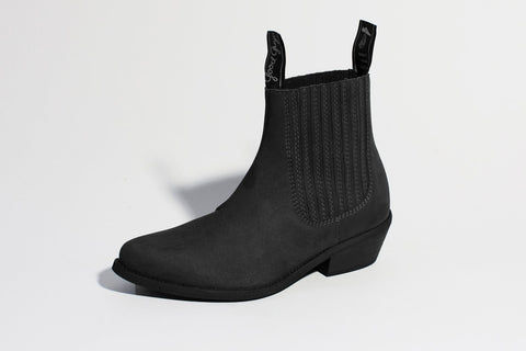 A black suede ankle boot with ribbing along the ankle.