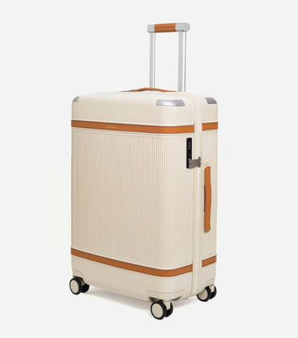 A standing white suitcase with two brown accent stripes and castor wheels.
