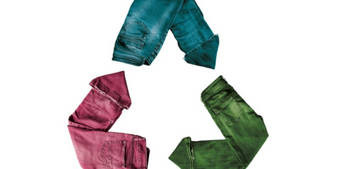A Recycling symbol made from jeans colored blue, green, and pink.