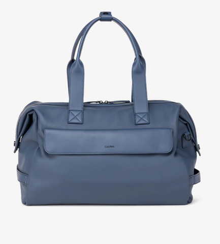 A small blue leather duffle bag.