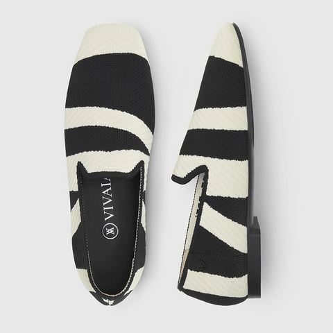 Black and white striped loafer shoes with the Vivaia logo printed in white letters on the insole.