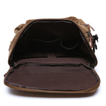 Load image into Gallery viewer, the main pocket of a brown backpack opened