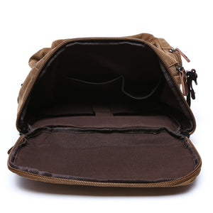 the main pocket of a brown backpack opened