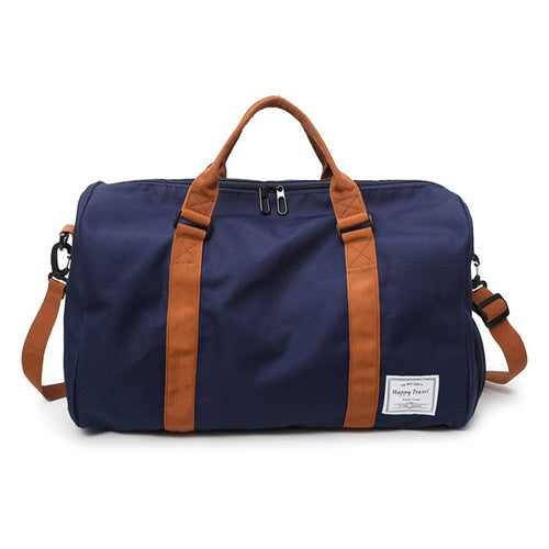 navy blue duffle with a handle and shoulder strap in brown