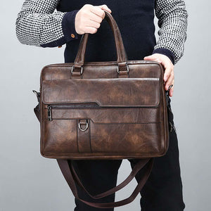 a guy holding a retro leather briefcase in coffee color