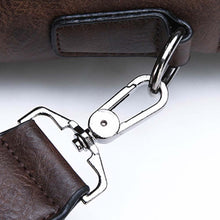 Load image into Gallery viewer, photo of the strap materials on a retro leather briefcase