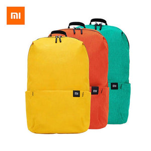 a backpack in three different colors, yellow, orange and green